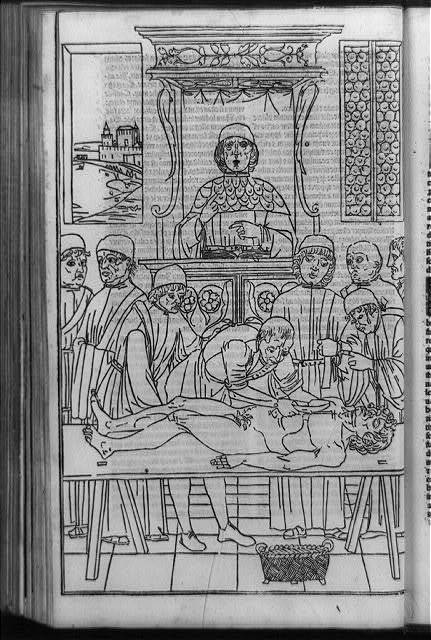 [Remondino de Luzzi overseeing assistant in dissection of cadaver as students watch in an early fourteenth century anatomy class at Bologna]