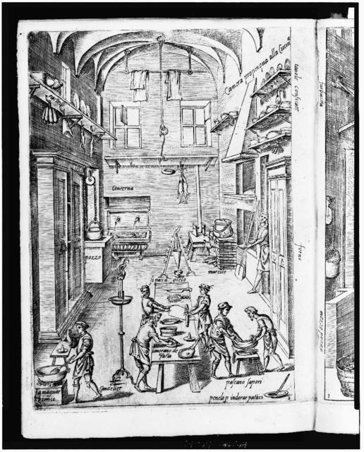 [Interior view of large, spacious kitchen with cooks preparing a meal]