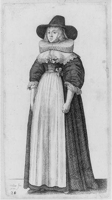 [Full figure of woman wearing ruffled collar and wide-brimmed hat]