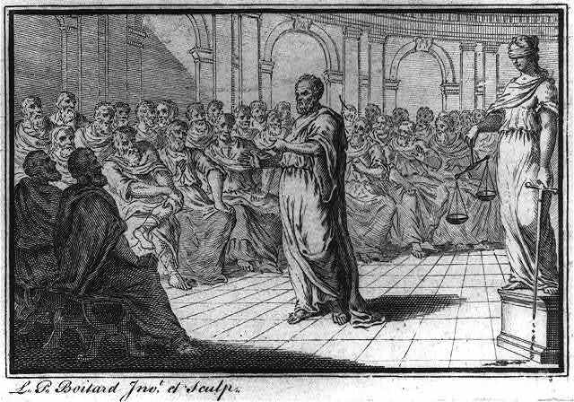 Socrates standing before seated group of men; figure of Justice stands behind him