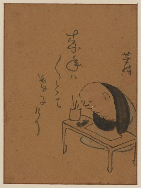 [A man or monk seated at a table, leaning on his arms, possibly asleep or meditating]