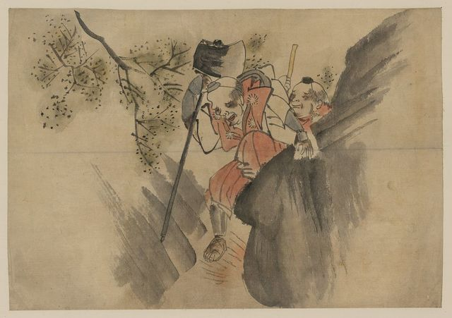 [Two men, one carrying a large axe, walking along a narrow mountain pass]
