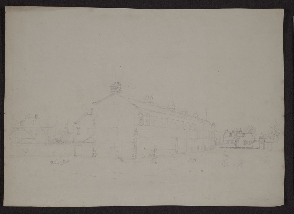 [View of the city of Charleston, South Carolina, with homes and outbuildings at left and right, and a long row of brick building, perhaps barracks, at center]