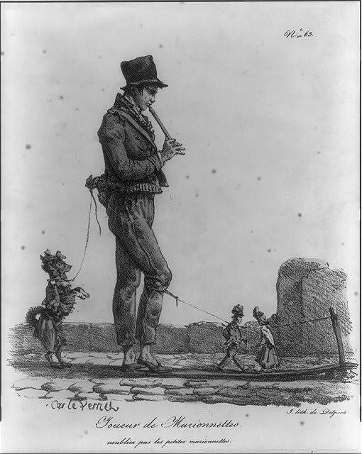 Musician with marionettes