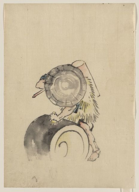 [A man, wearing a large conical hat and a straw or feather garment, leaning on or rolling a large barrel-like object, possibly a mochi tub; he is carrying a long-handled tool, possibly a mallet, over his right shoulder]