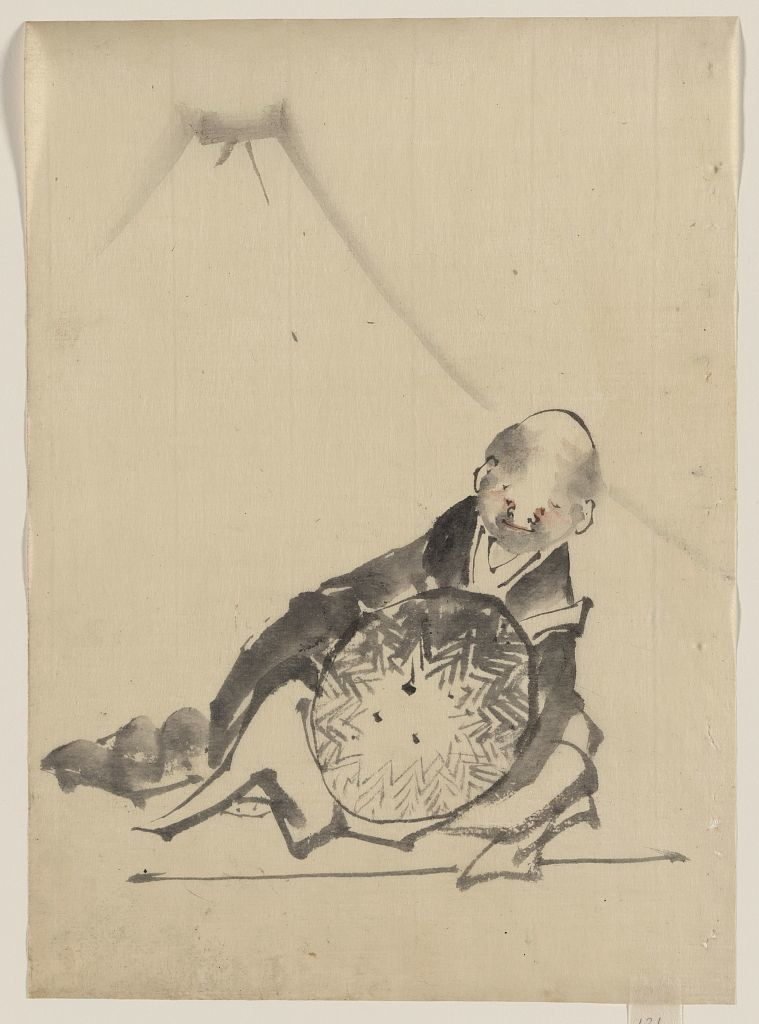 [A monk reclining, holding a large conical hat in front of him, with view of Mount Fuji in the background]