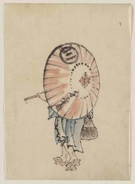 [A person walking to the left, mostly obscured by an open parasol carried over the shoulder, wearing kimono and geta, and carrying a bag in right hand]