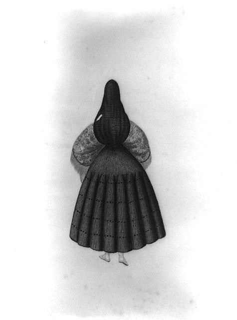 Back view of a standing woman wearing a tapada, Peru
