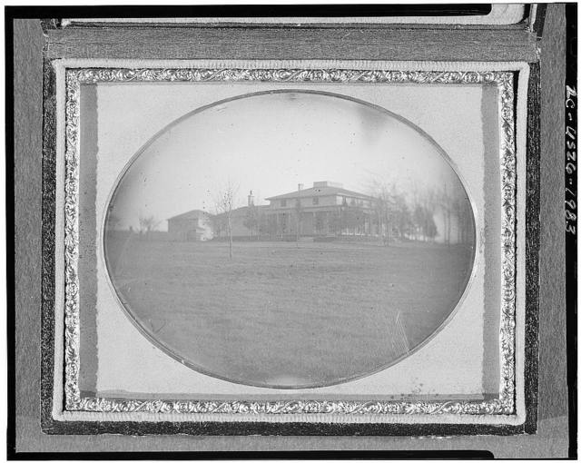 [Distant view of a house and yard]