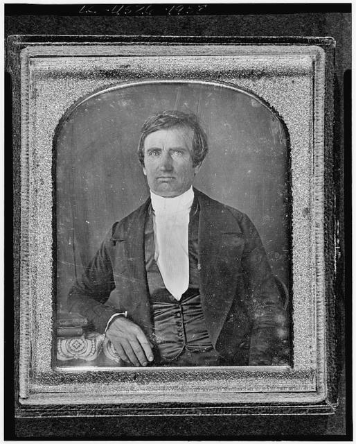 [Nathaniel Green, half-length portrait, facing front, seated with arm on table with tablecloth]