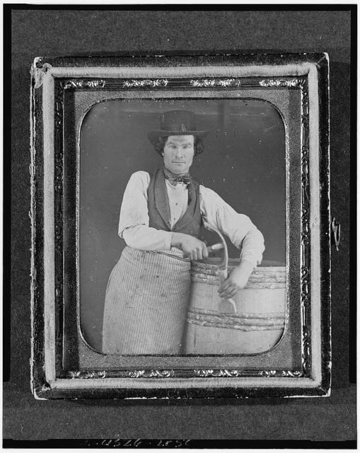 [Occupational portrait of a cooper, three-quarter length, with barrel and tools]