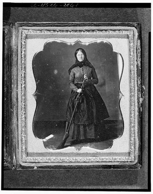 [Occupational portrait of an unidentified woman with broom, full-length, facing front]