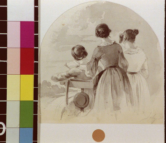 [Two women standing over seated reading woman]