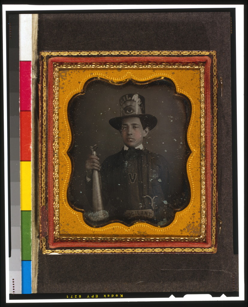 [Vigilant Fire Company, Baltimore, firefighter, half-length portrait, facing front, wearing parade hat and holding speaker trumpet]
