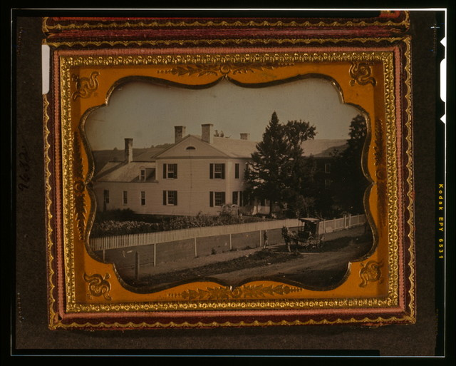 [White frame house with white picket fence at Cambridge, New York, with horse and buggy in front