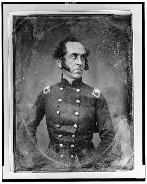 [James Duncan, three-quarters to the right, in military uniform]