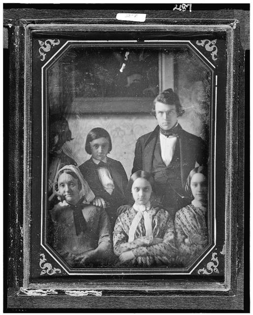 [Members of the Cresson and Prichett families, with three seated women in front and two men and a boy in the back, standing in front of a framed picture or mirror]
