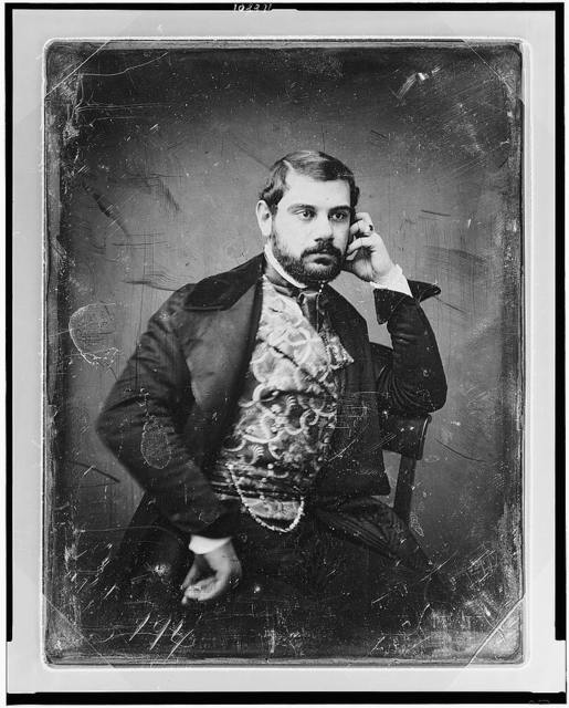 [Sesto Benedetti, three-quarter length portrait, facing three-quarters to right, with beard, sitting in chair, wearing large ring and figured waistcoat]
