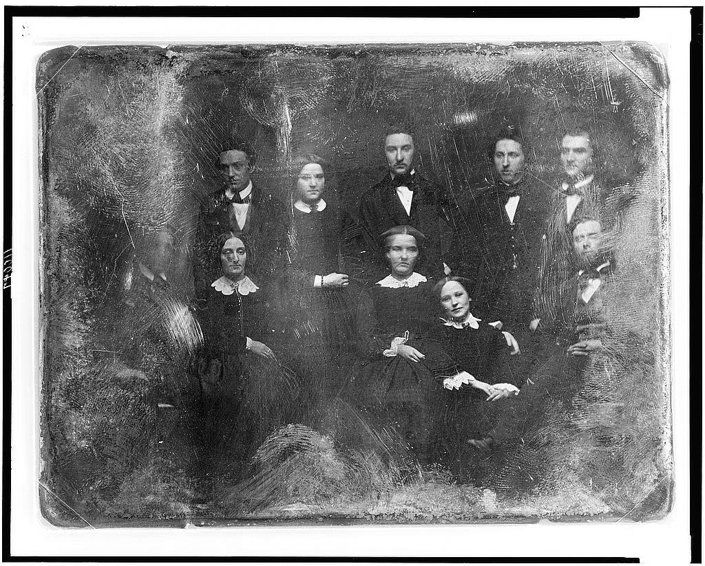 [Ten unidentified young people, four men and one woman are standing, seated in front are two men and three women, all facing nearly front]