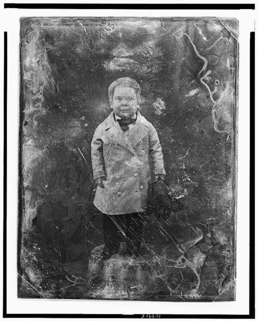 [Tom Thumb, full-length portrait, facing front, standing on table with tablecloth]
