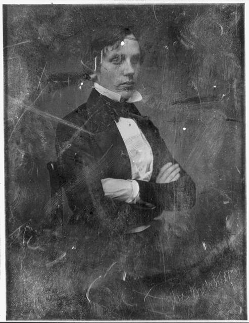 [Unidentified man, about 25 years of age, three-quarter length portrait, three-quarters to the right, seated in chair, with arms folded]
