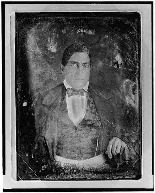 [Unidentified man, about 40 years of age, half-length portrait, nearly facing front, hand resting on table with tablecloth]