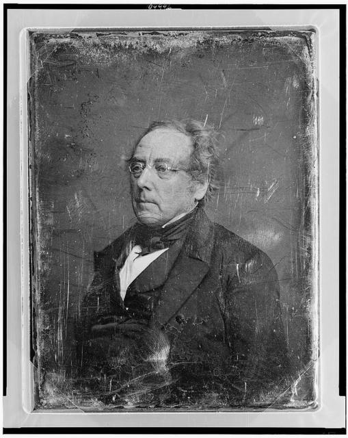 [Unidentified man, about 50 years of age, half-length portrait, three-quarters to the left, wearing spectacles]