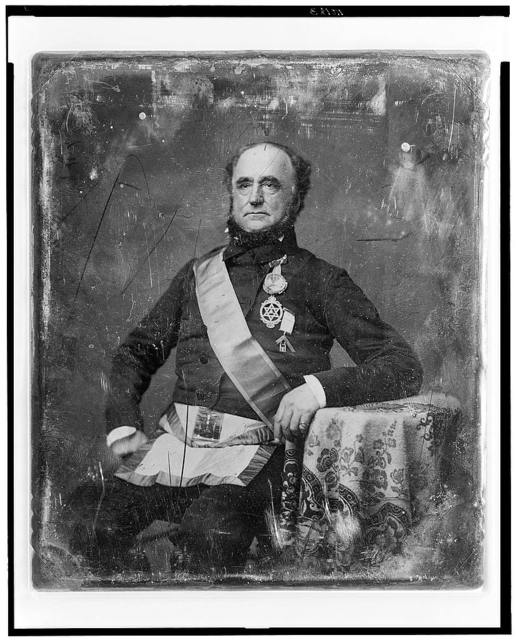 [Unidentified man, about 60 years of age, in Masonic regalia, three-quarter length portrait, three-quarters to the left, seated at table with tablecloth]