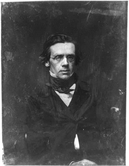 [Unidentified man, half-length portrait, slightly to the right, wearing spectacles]