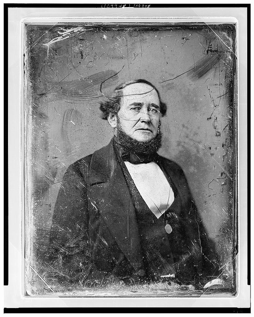 [Unidentified man, half-length portrait, three-quarters to right, eyes front, with monocle suspended around neck]