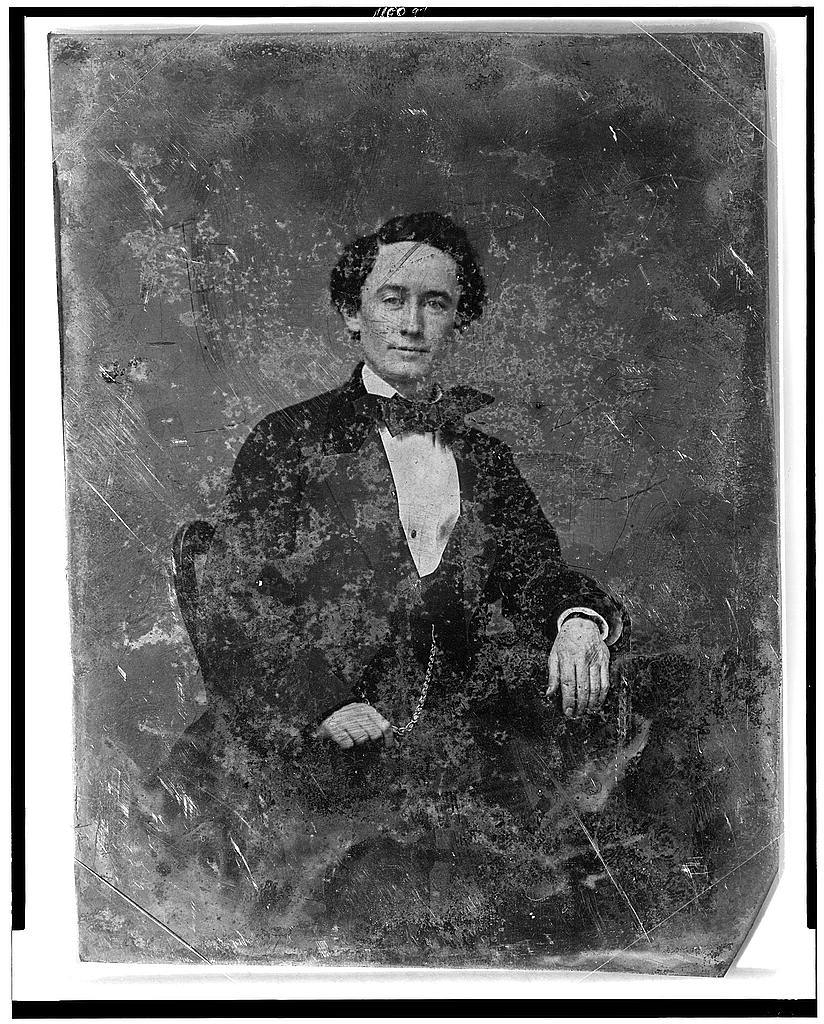 [Unidentified man, half-length portrait, three-quarters to the left, seated in chair]