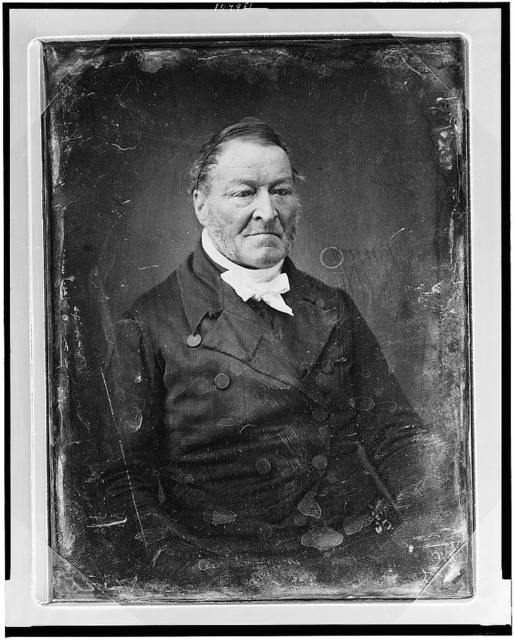 [Unidentified man, half-length portrait, three-quarters to the right, with side whiskers]