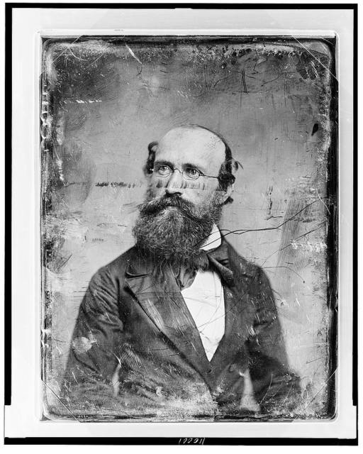 [Unidentified man, head-and-shoulders portrait, slightly to the right, head slightly to the left, with spectacles and full beard]