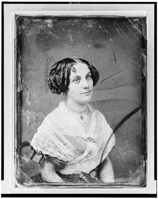 [Unidentified woman, about 25 years of age, half-length portrait, three-quarters to right, wearing white lace shawl]