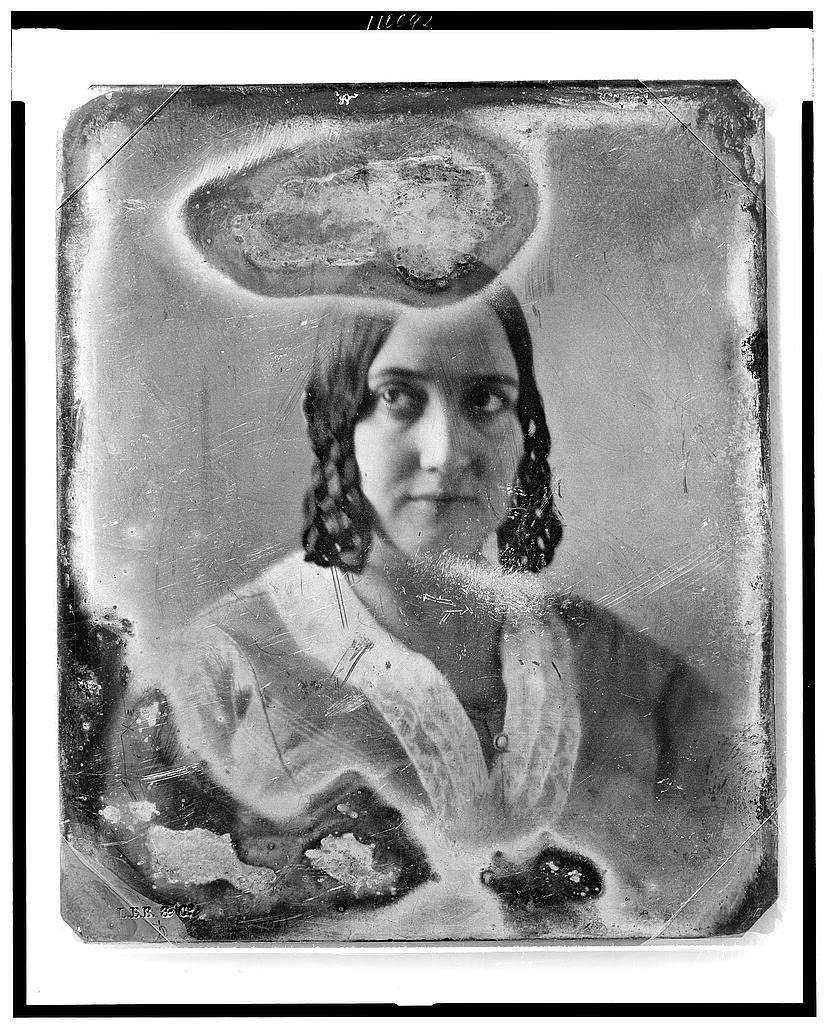 [Unidentified woman, head-and-shoulders portrait, facing front]
