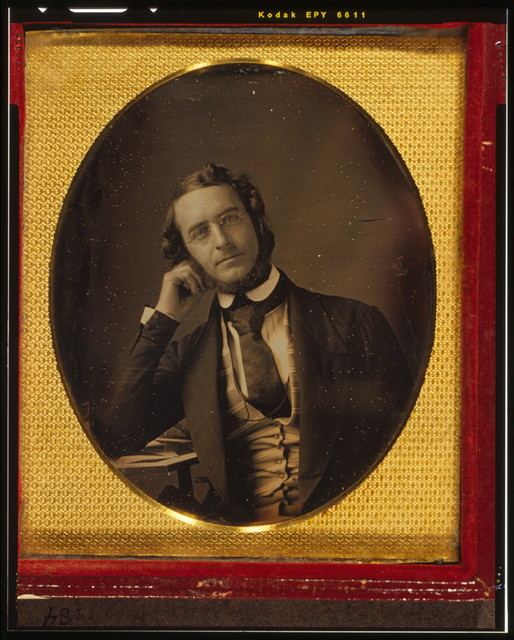 [James Curtis Booth, half-length portrait, seated with arm resting on table]