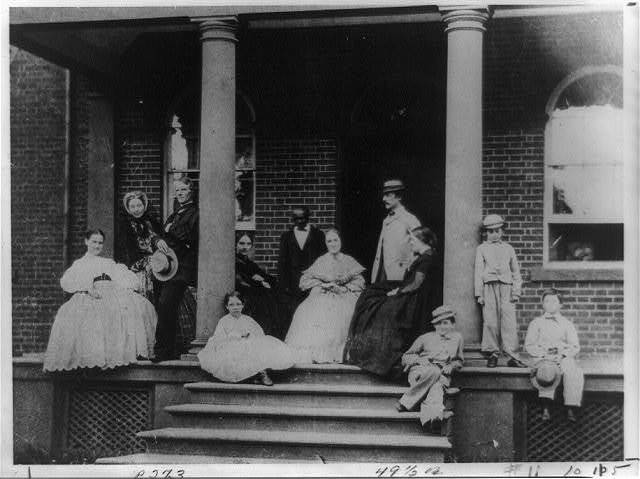 Daniel Carroll of Duddington's family on porch of house, F and 2nd Streets, S.E., Washington, D.C.