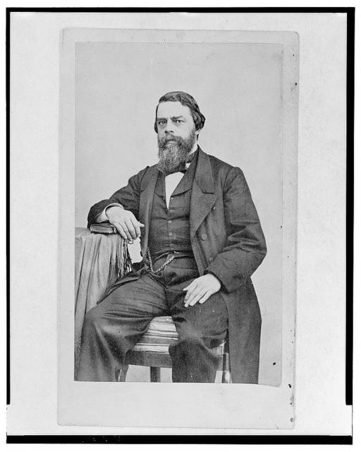 [General Zires, three-quarter length portrait, seated, facing front]