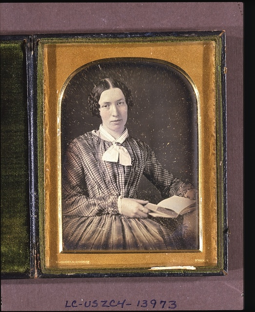 [Mary H. Lee, half-length portrait, seated, holding a book]