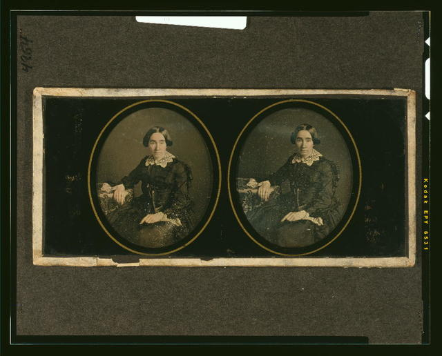 [Mrs. William Y. McAllister, half-length, seated, with arm resting on table with tablecloth]
