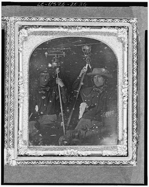 [Occupational portrait of two unidentified surveyors with their tools, a level and a theodolite]