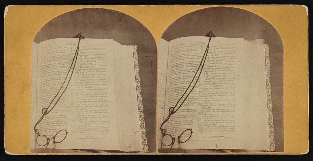 The Book of Psalms open with reading glasses