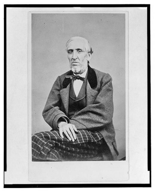[Three-quarter length portrait of a man, seated, facing front]