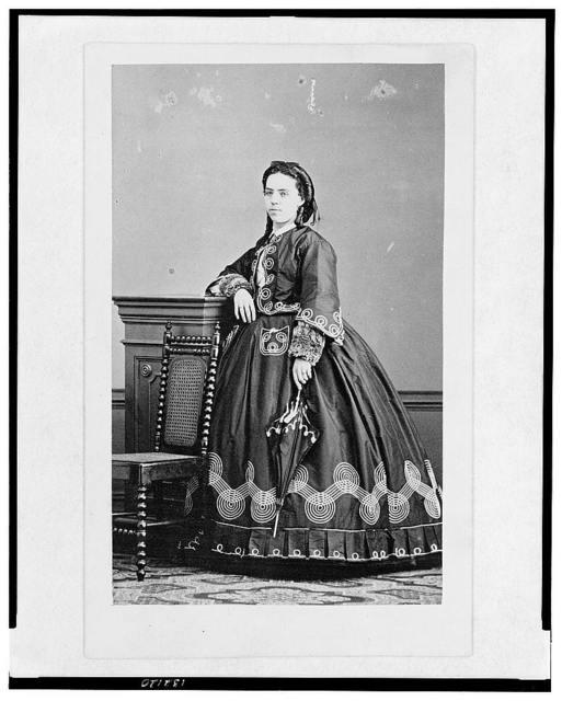 [Woman with unopened parasol, half-length portrait, facing front]