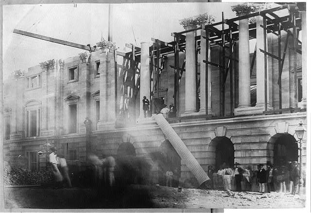 [Column being raised into setting during construction of U.S. Post Office]