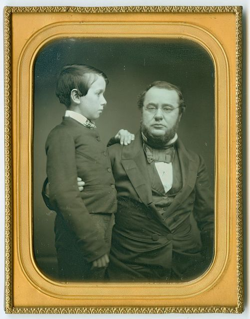 [Edwin McMasters Stanton, seated, with his son Edwin Lamson Stanton, standing in profile]
