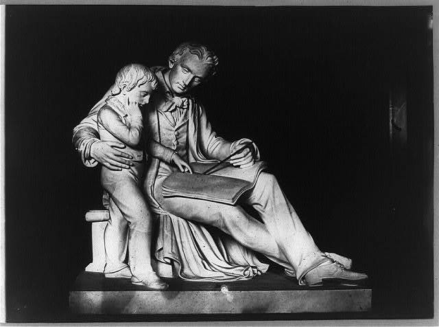 [Sculpture of man and boy reading book]