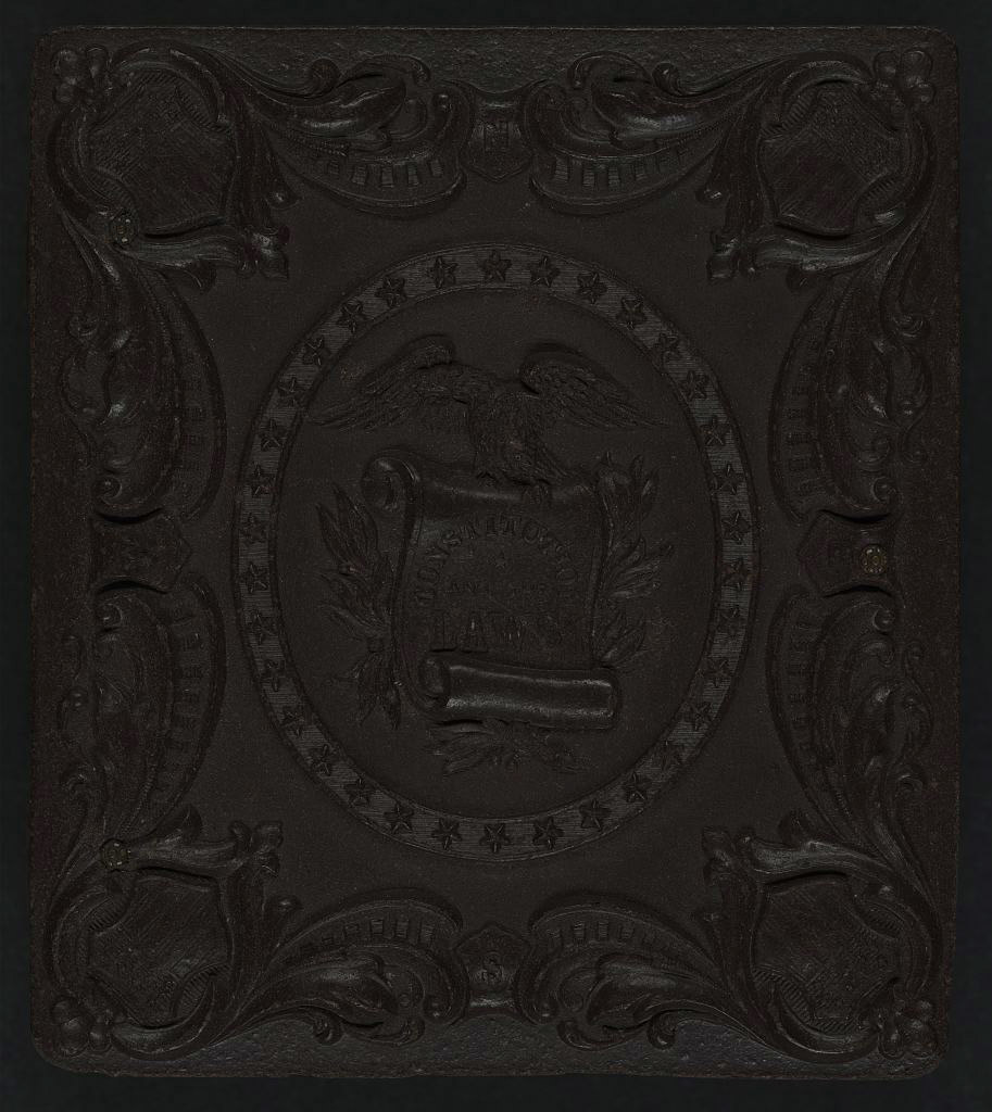 """[Union case for daguerreotype, ambrotype, or tintype showing eagle grasping scroll stating """"Constitution and the Laws"""" within patriotic scroll frame]"""