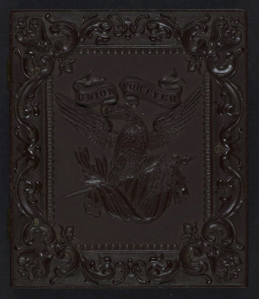 "[Union case for daguerreotype, ambrotype, or tintype showing eagle holding banner stating ""Union Forever"" in its beak and American flag in its talons]"