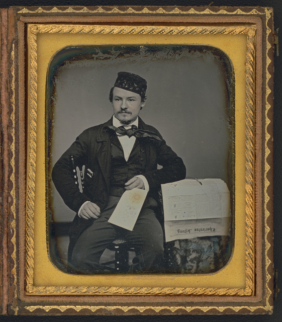 [Portrait of seated man holding the Charleston Zeitung, possibly the owner of the newspaper company, Franz Melchers]